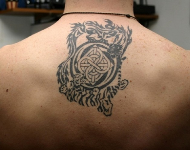 Amazing Tribal Design Tattoo For Men On The Back