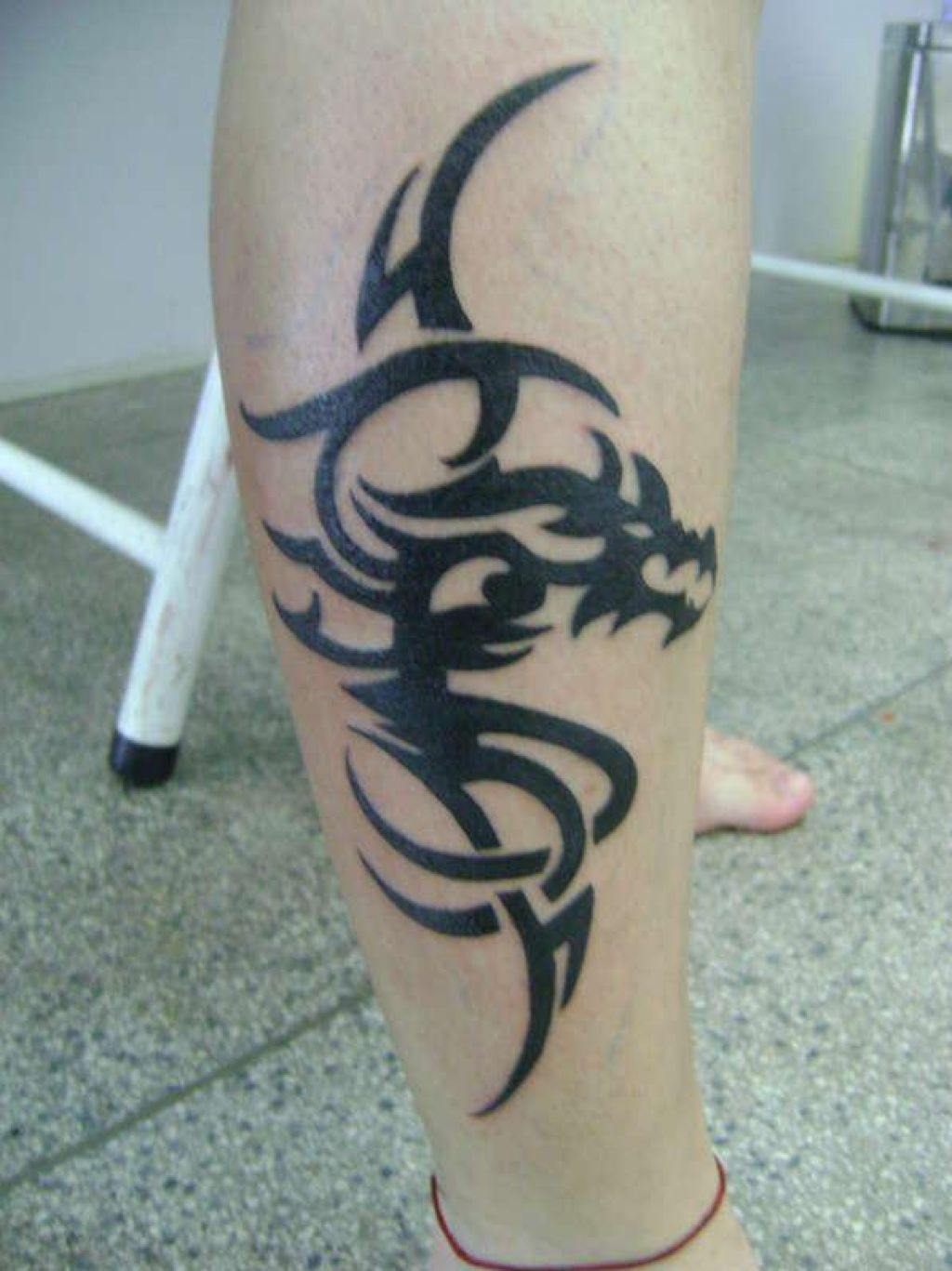 Artistic Bold Black Tribal Dragon On Leg Pictures