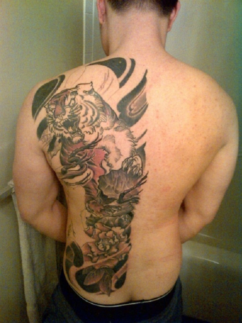 Awesome Half Back Tiger Piece Men Tattoos Pictures