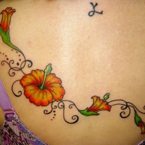 Awesome Ladyline Hibiscus Tattoo On Back Pictures