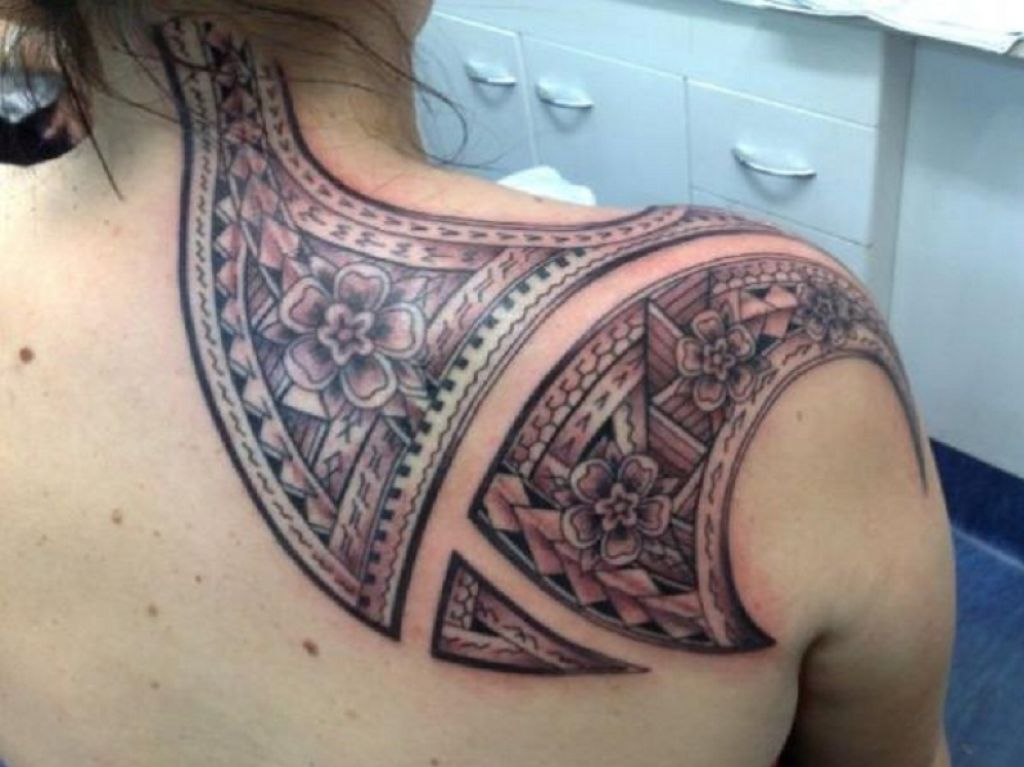 Awesome Shoulder Blade And Back Neck Tribal Flower Tattoo Detailed Pictures