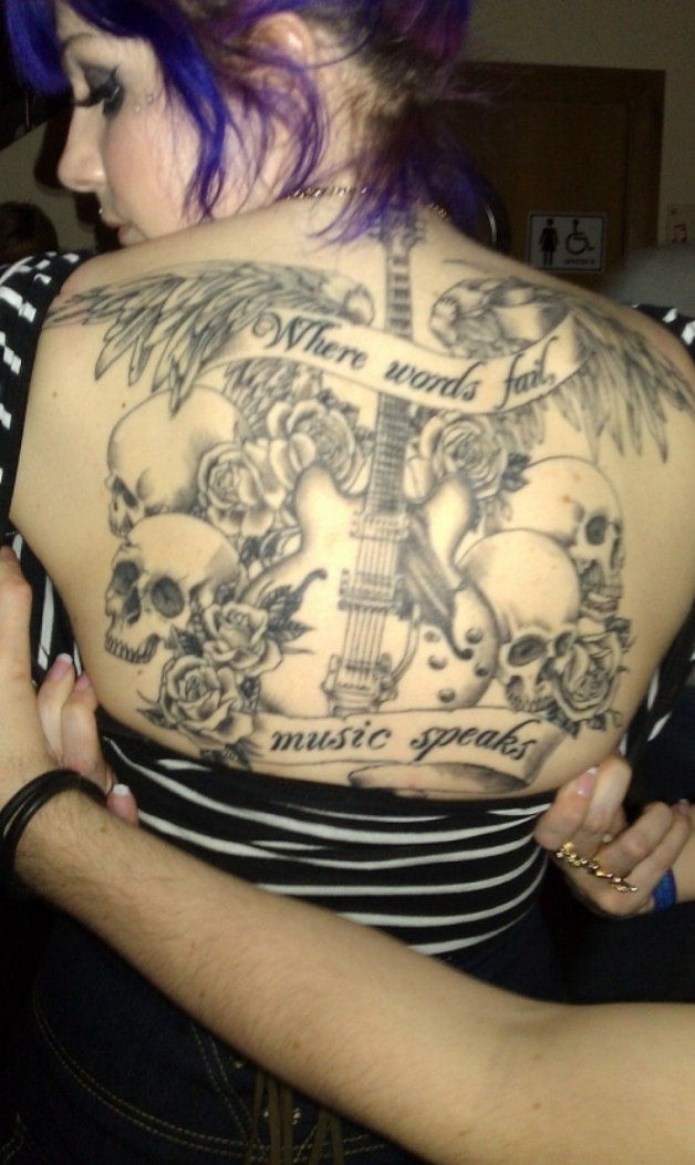 Back Lettering Tattoo For Music Lovers