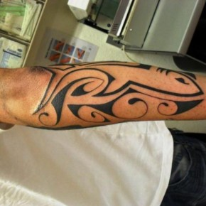 Beautiful Back Forearm Fish Tribal Tattoo Pictures