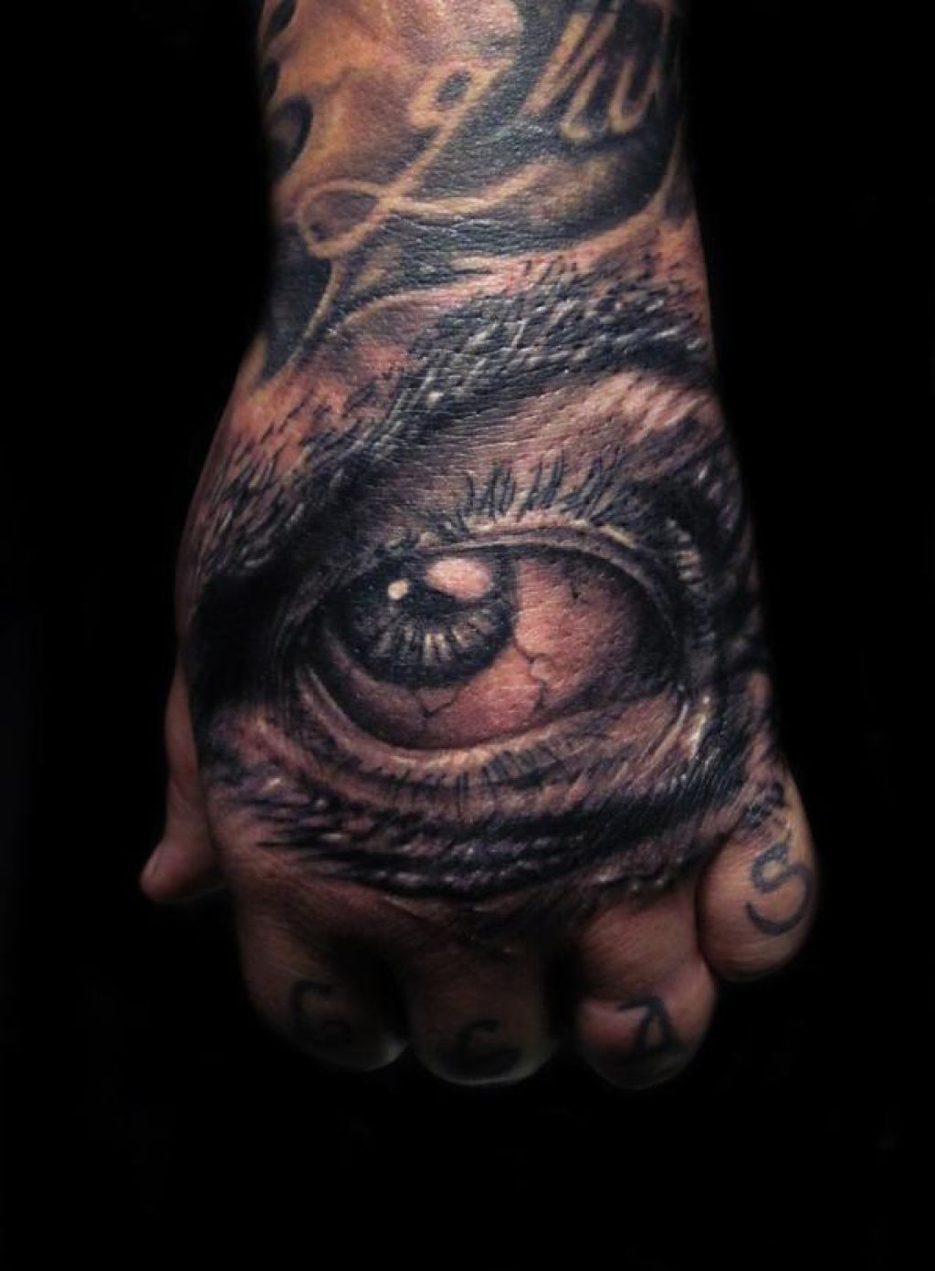 Big Black Eye Hand Tattoo Design Ideas Pictures