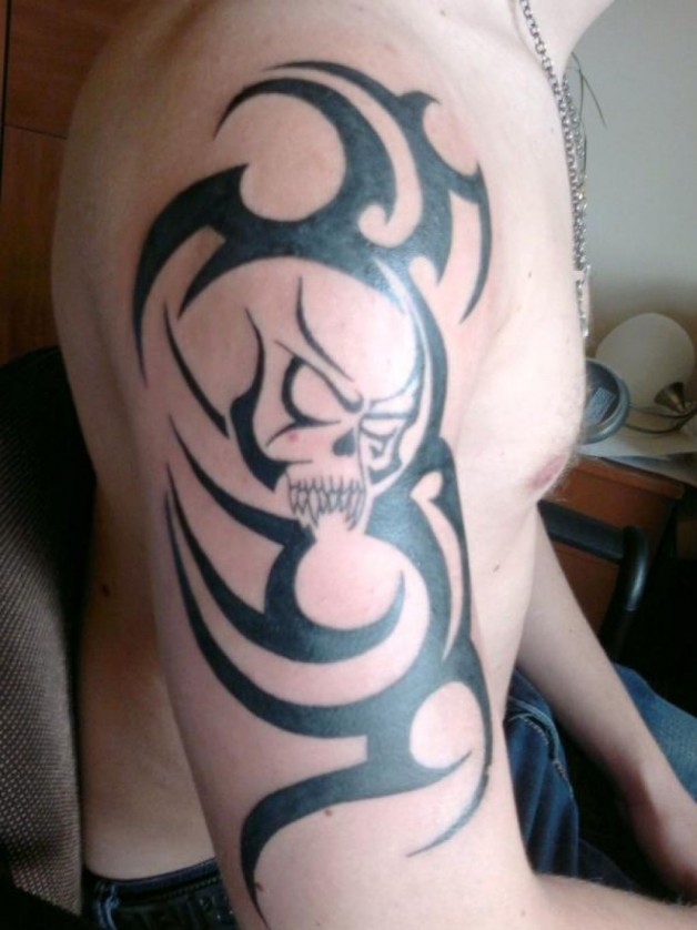 Big Tribal Skull Tattoo On Arm