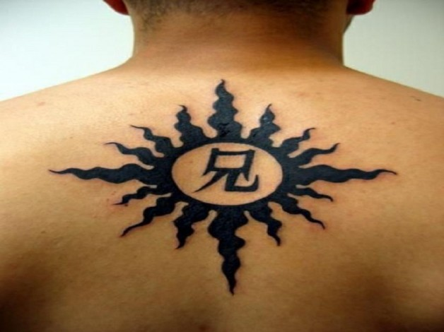 Black Sun Tribal Men Tattoo On Back