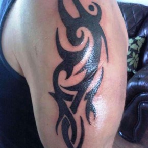 Bold Black Tribal Upper Arm Tattoo Pictures
