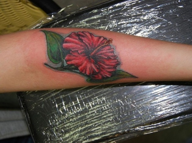 Bright Red Hibiscus Flower With Green Leaves For For Forearm Tattoo