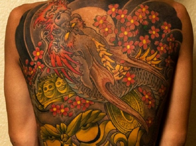 Colorful And Vibrant Full Body Tattoo With Red And Yellow Color Combo