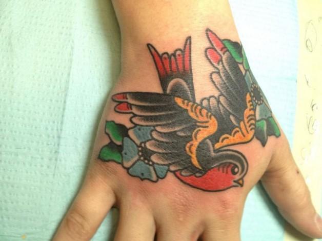 Colorful Bird Tattoo On Hand