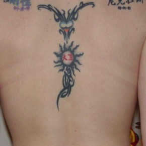 Cool Tribal And Chinese Kanji Tattoos On Several Piece Of Back Pictures