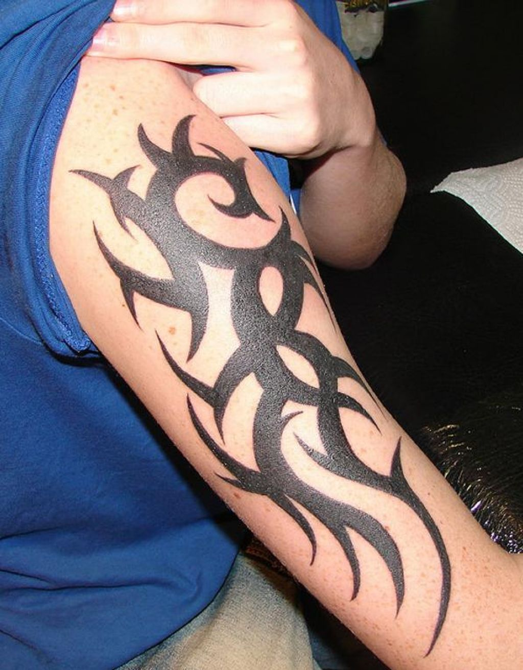 Cool Vertical Barb And Tribal Tattoo On Half Sleeve Pictures