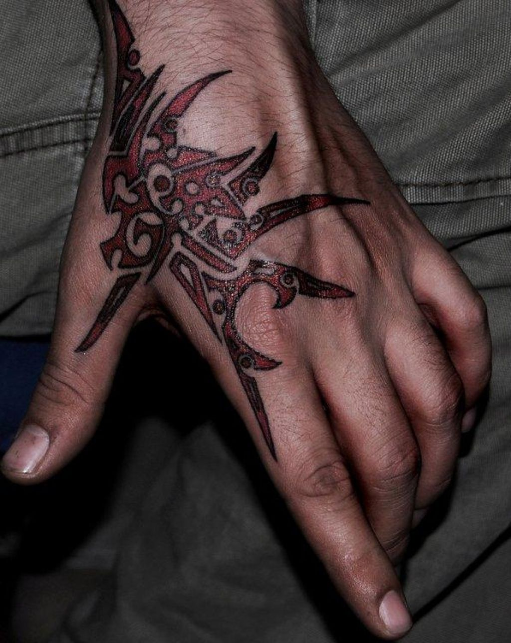 Glossy Red Dragon Tribal Tattoo On Hand Pictures