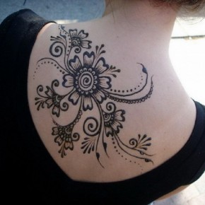 Large Black Henna Tattoo On Back Pictures