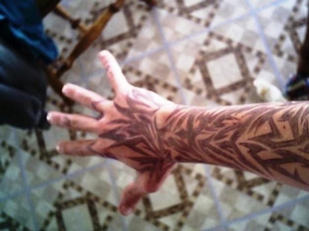 Light Brown Full Arm Tribal Tattoo Ideas