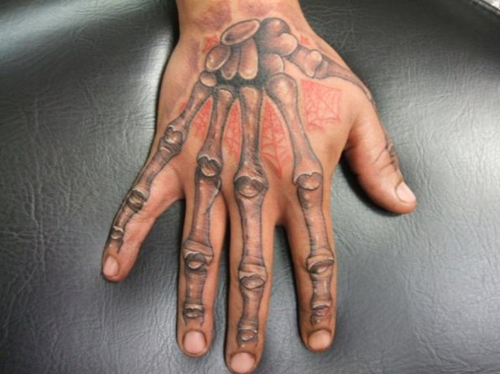 Nice Skeleton Hand Tattoo Ideas Pictures