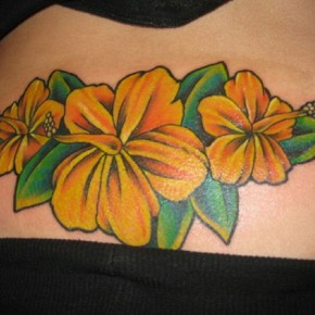 Orange And Yellow Shaded Hibiscus Hip Tattoo Pictures