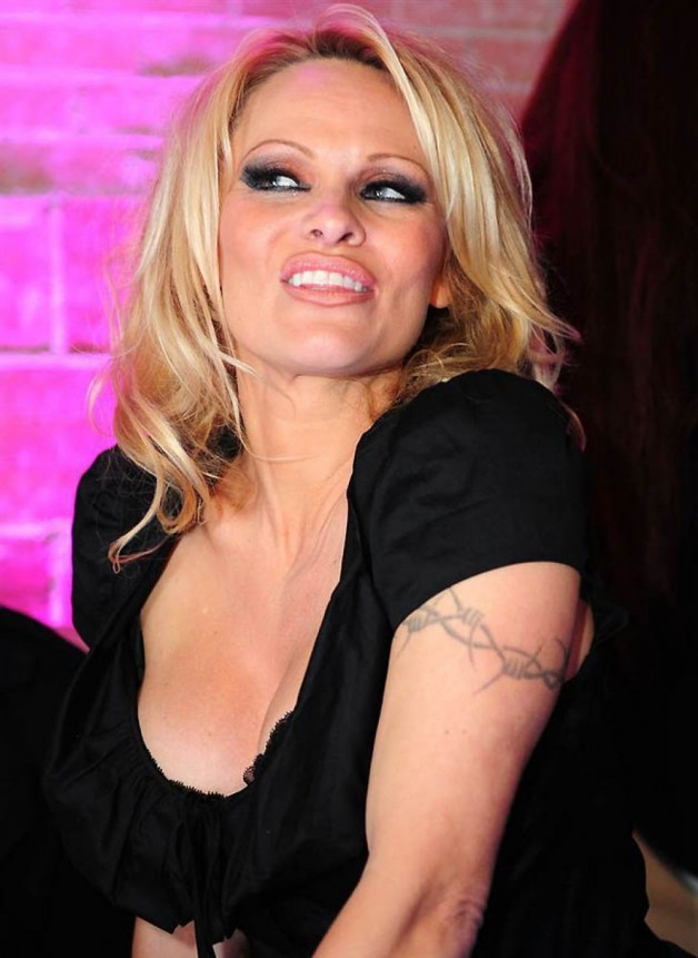 Pamela Anderson Tattoo With Barbed Wire Form On Left Shoulder