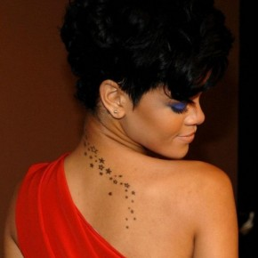 Rihanna With Star Tattoo Designs On The Upper Back Pictures