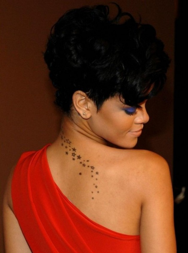 Rihanna With Star Tattoo Designs On The Upper Back