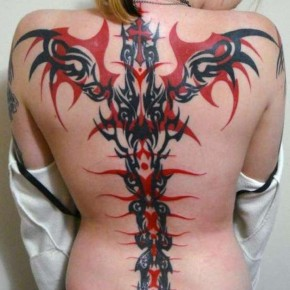Striking Red Black Full Back Tribal Tattoo For Women Pictures