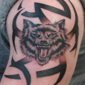 Stunning Wolf Tribal Tattoo On Arm Pictures