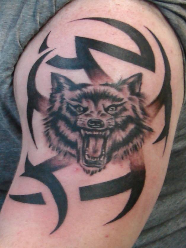 Stunning Wolf Tribal Tattoo On Arm
