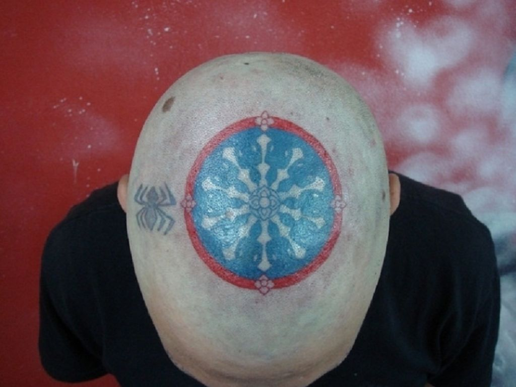 Symbol Of The Land Of Buddha Tattoo On Head Pictures