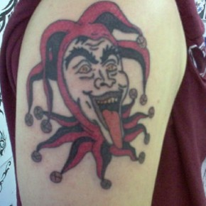 Upper Arm Red Joker Tattoos Pictures